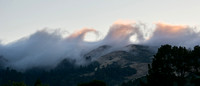 Waves of Fog crashing over Windy Hill at Sunset